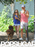 Amanda Seyfried and a friend took Amanda's dog for a walk.
