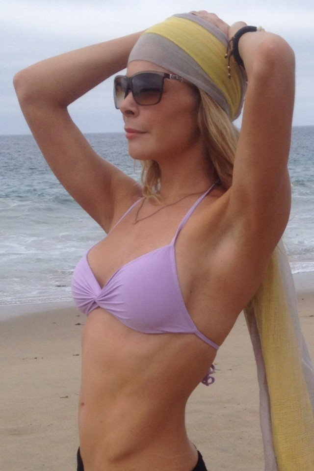 LeAnn Rimes wore a purple bikini and headscarf on the beach in August 2012. Source: Twitter user LeAnn Rimes
