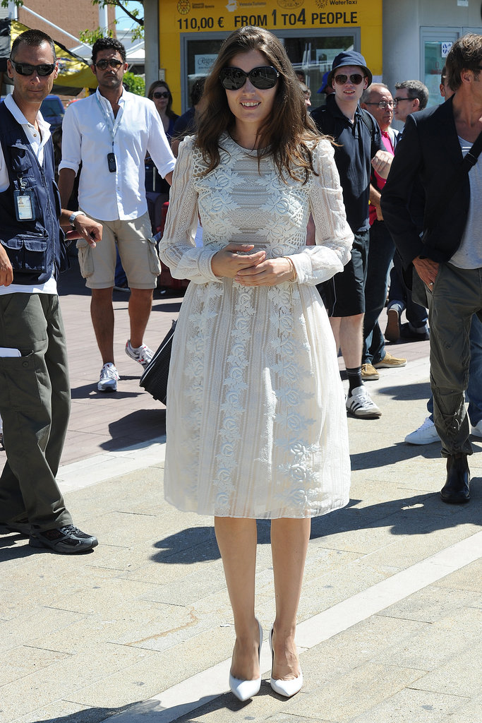 Laetitia Casta donned one of Valentino's ultraromantic white lace dresses with slick white pumps and oversize sunglasses.