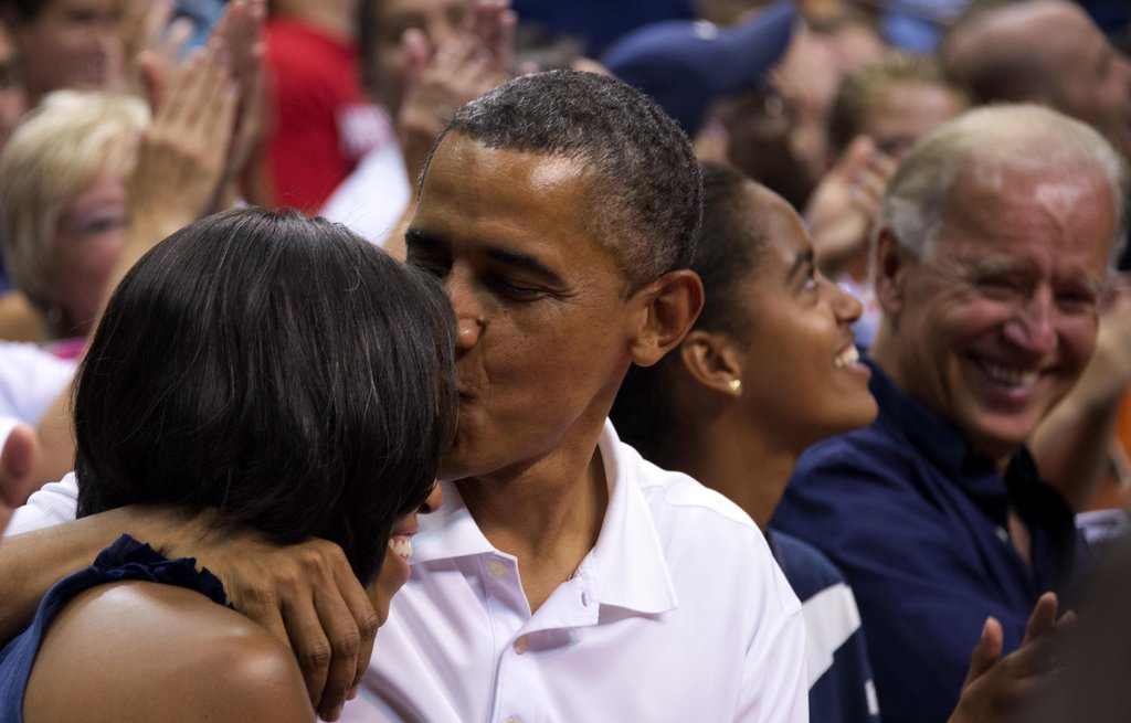 The Obamas kissed after getting caught on the Kiss Cam at a Washington DC basketball game.