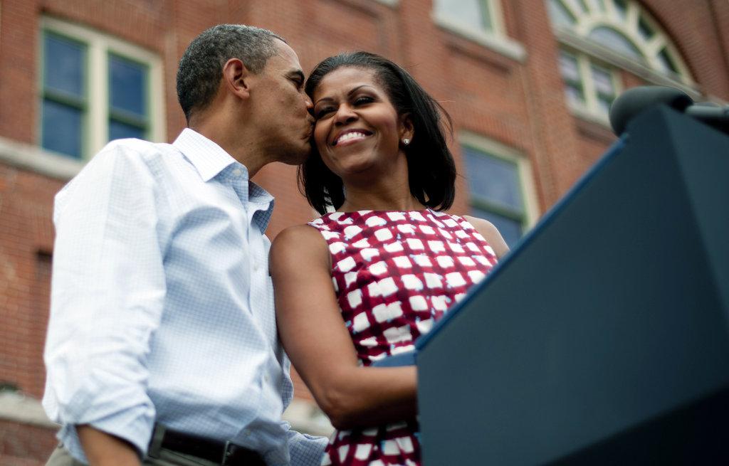Barack kissed Michelle on the cheek.