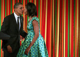 The Obamas went in for the kiss.