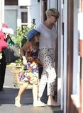 Michelle Williams had her arm around Matilda as they walked into the ice cream shop.