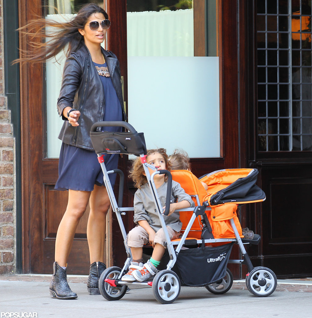 Camila Alves wore a blue dress and leather jacket to take the kids for a walk in NYC.