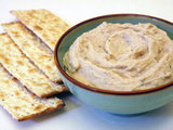 When you're craving a cheesy dip, this white bean variation is a nice stand-in. Cannellini beans get blended together with olive oil to create a smooth dip perfect for veggies or pita.