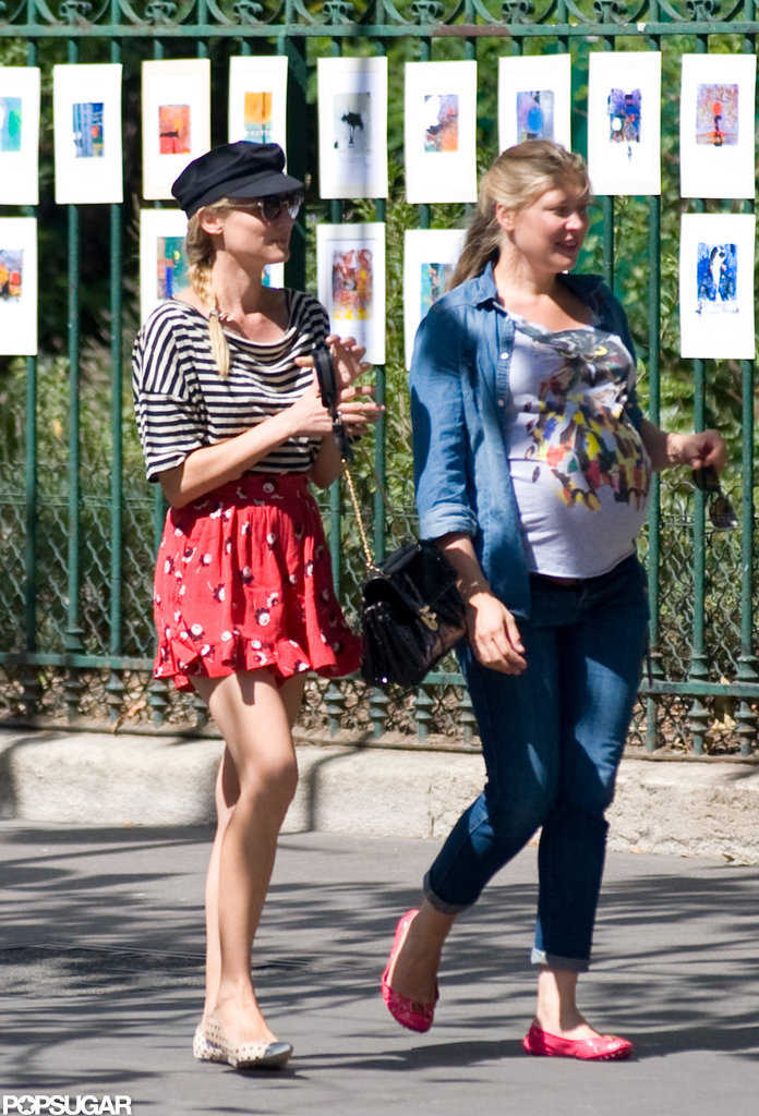 Diane Kruger showed off her legs in a skirt and flats as she and a friend took a walk.
