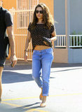 Mila Kunis wore low-rise jeans with a crop top in LA.