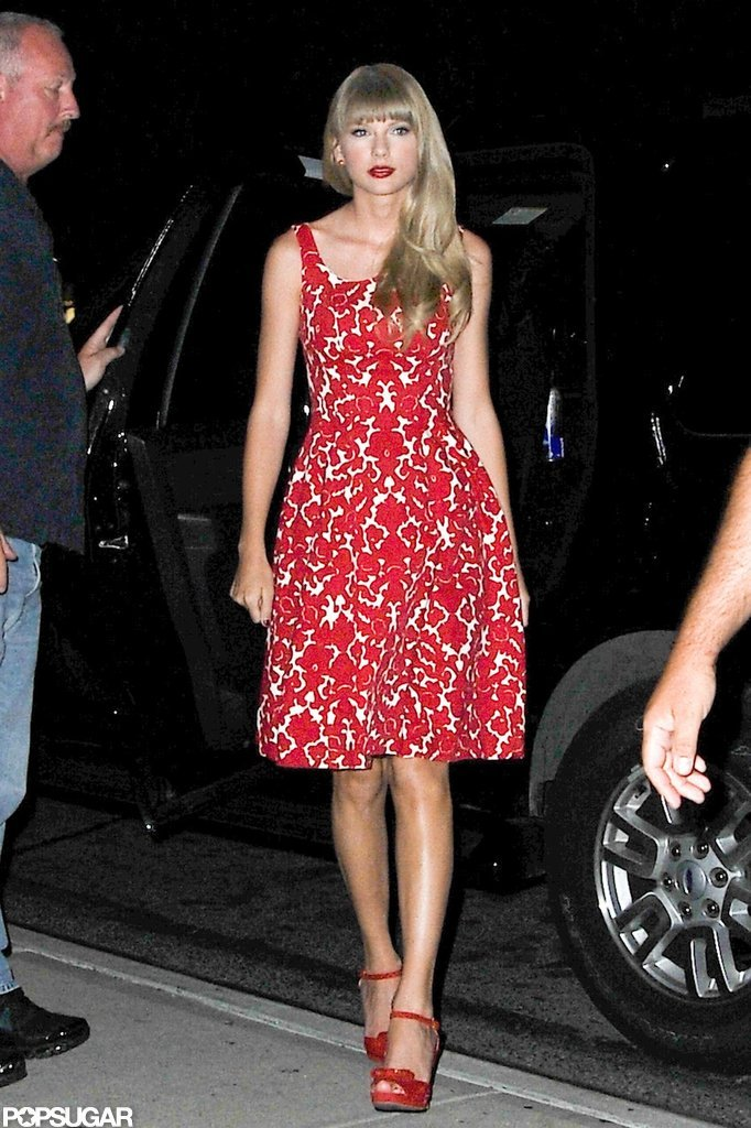 Taylor Swift wore a red flowered dress out in NYC.