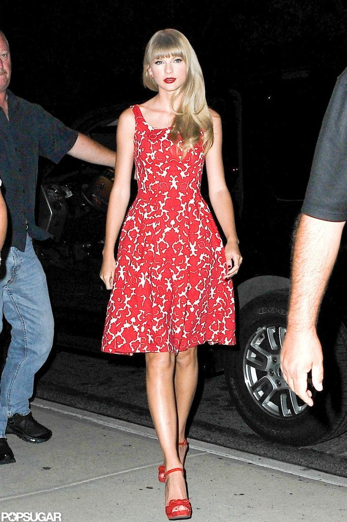 Taylor Swift wore bright red lips to match her red dress and shoes in NYC.