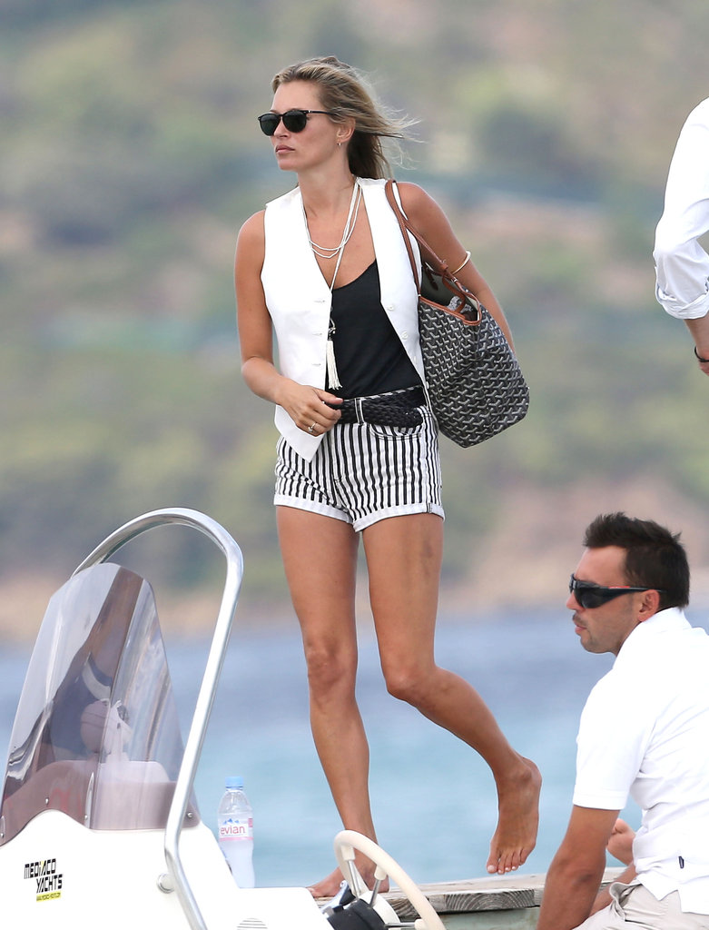 Kate Moss showed off her perfectly downtown-cool-meets-bohemian styling sense while vacationing in Saint-Tropez. We're smitten with the effortless combination of a clean white vest and pinstriped Topshop shorts.