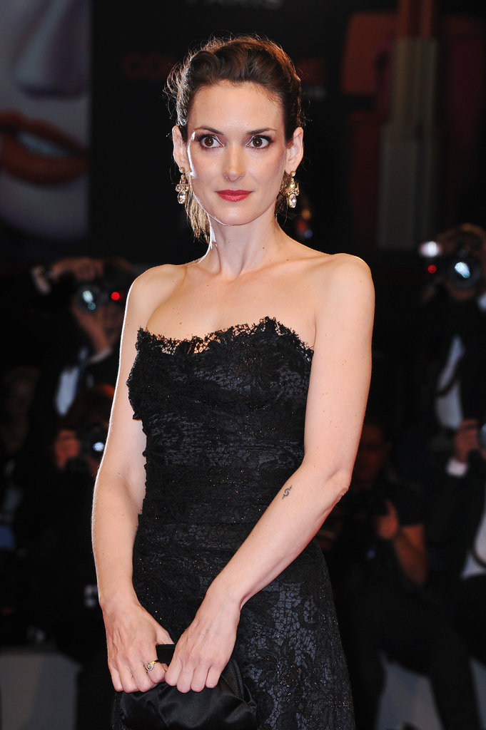 Her stunning Lanvin earrings made an equally poignant statement against her lacy Dolce & Gabbana gown.