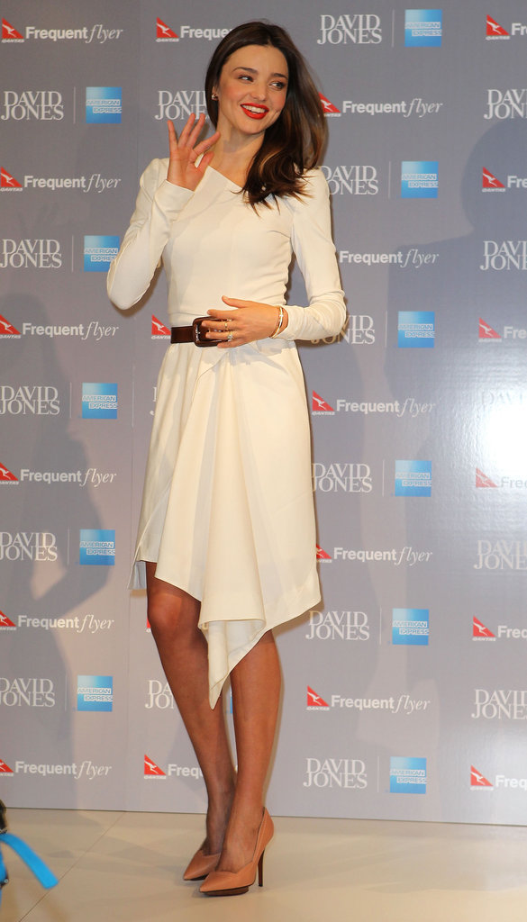 Miranda Kerr lit up a press conference in a chic white Willow dress.