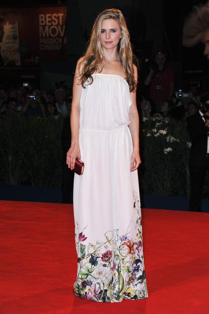 Brit Marling took a bohemian approach, albeit a very pretty one, to her red carpet premiere, wearing a floral Gucci Resort 2013 gown with a satin red Gucci clutch.
