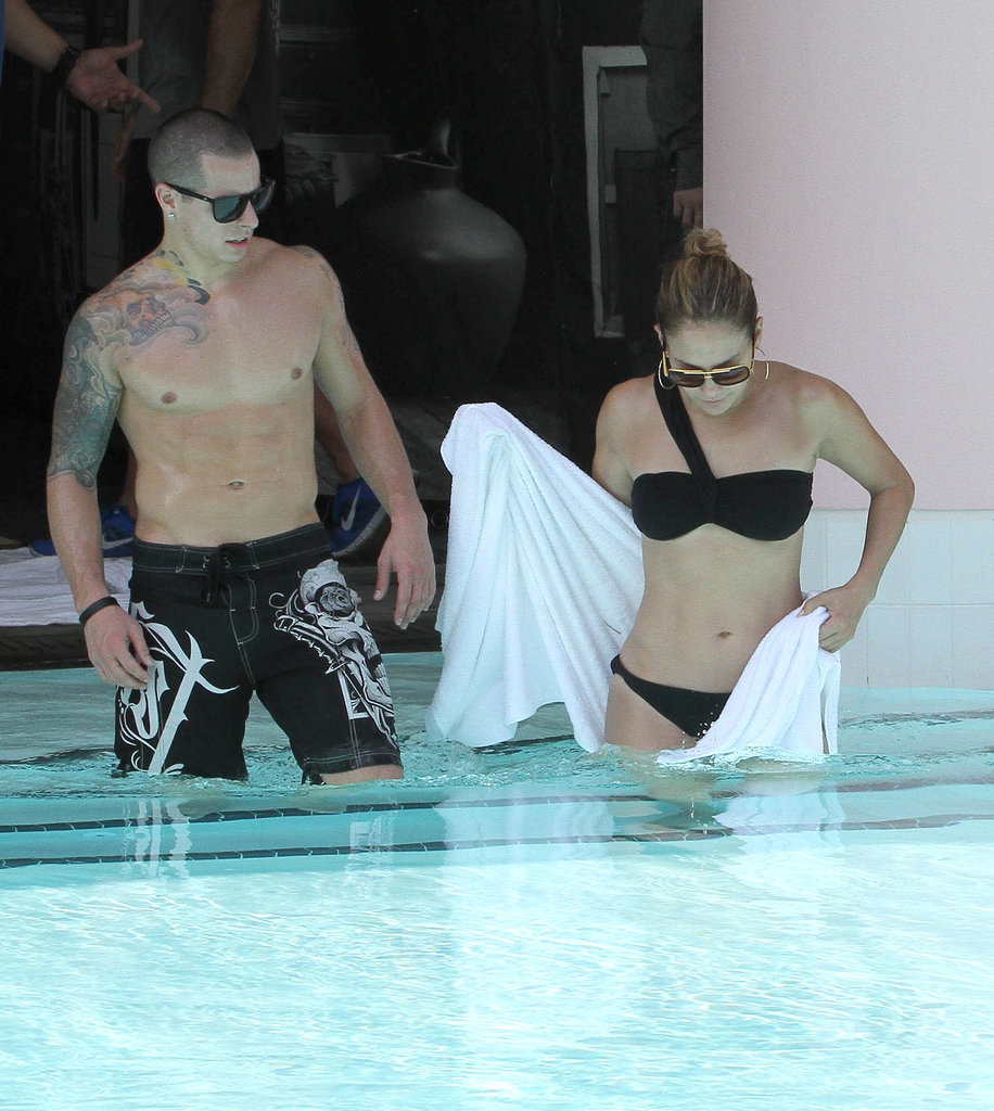 Jennifer Lopez wore a black bikini to take a dip in the pool with Casper Smart.