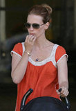 January Jones wore a bright orange shirt.