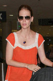 January Jones wore sunglasses and a necklace.