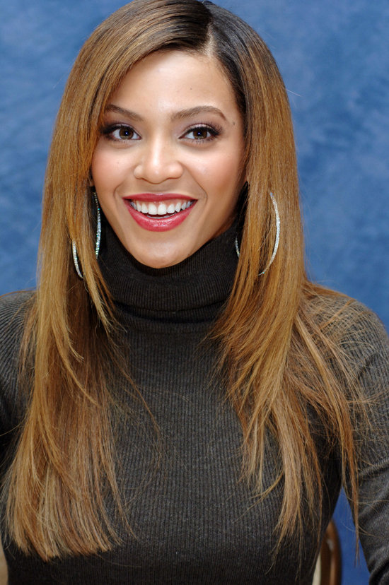 Beyoncé opted for bright red lips and pin-straight strands during a press conference for Dreamgirls in 2006.