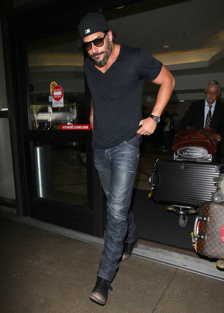 Joe Manganiello wore a backwards cap and sunglasses at LAX.