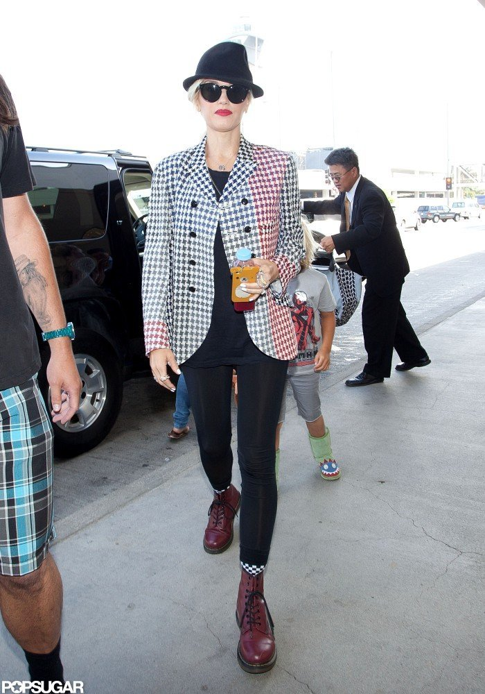 Gwen Stefani wore a checkered blazer and black hat to travel from LAX.