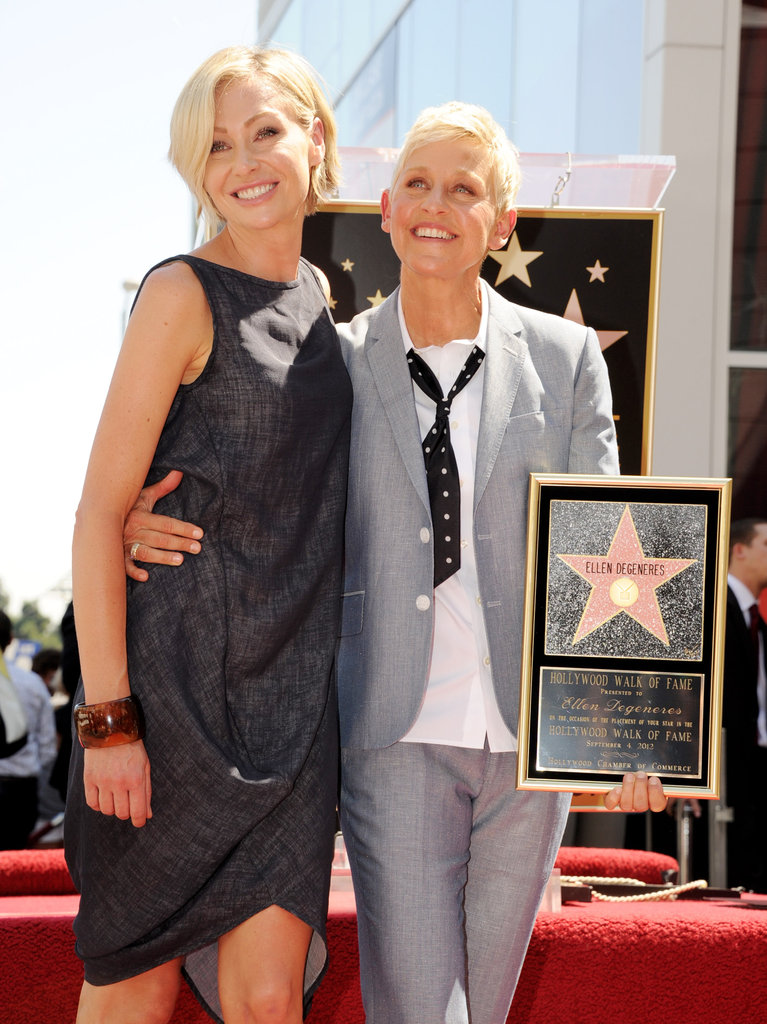 Ellen DeGeneres and Portia de Rossi posed together while Ellen accepted her star.