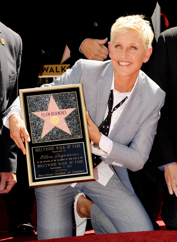 Ellen DeGeneres posed with her plaque.