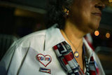 A woman wore an Obama pin at the DNC.