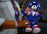 A lady held a patriotic stuffed bear.