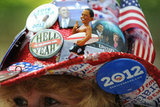 This lady's hat was decorated to the hilt with Obama pins.