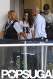 Kristen Stewart was escorted through LAX.