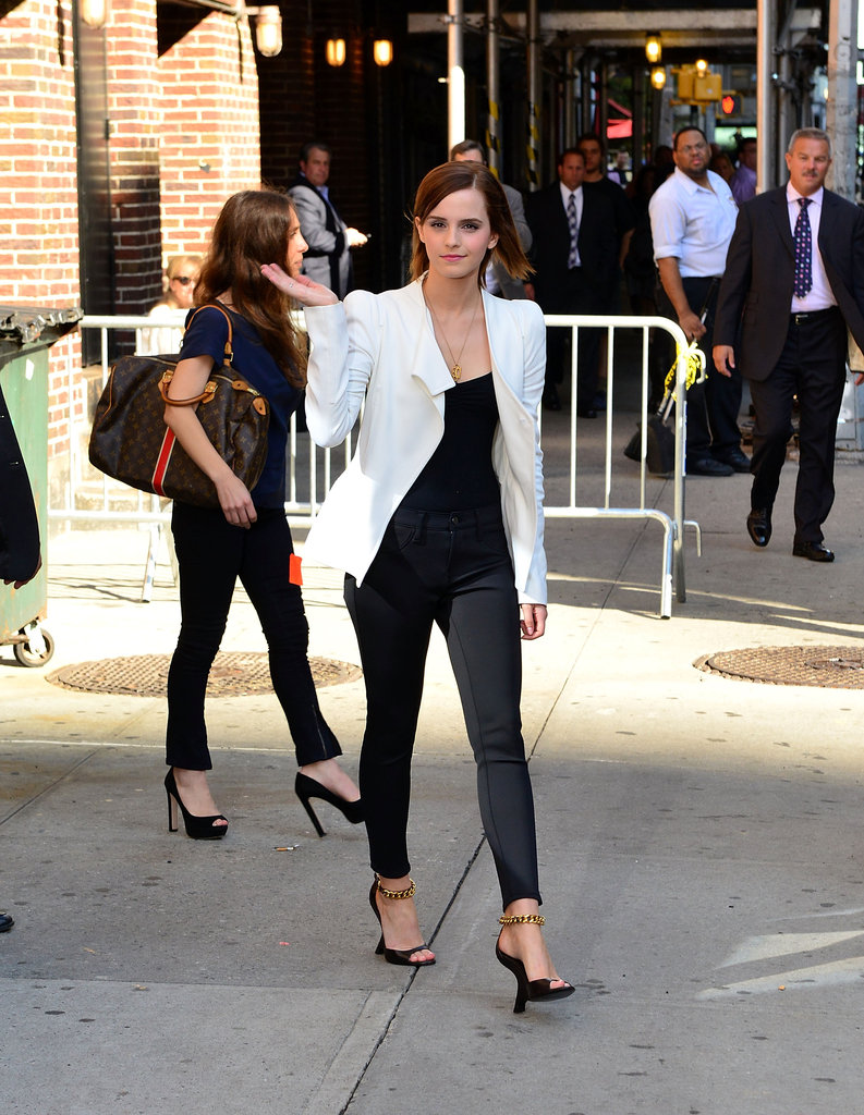 Emma Watson wore black heels with a gold chain.