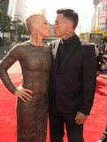 Pink and her husband Carey hart shared a sweet moment on the red carpet.