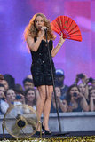 Mariah Carey pulled out a red fan at the NFL Kickoff concert in NYC.