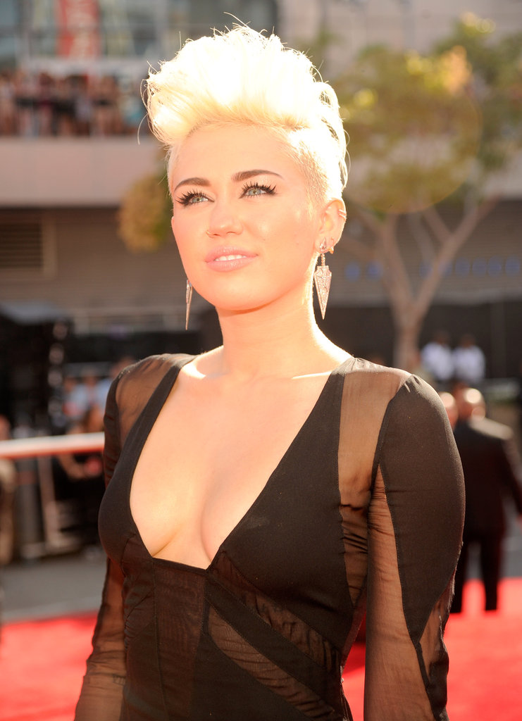 Miley Cyrus rocked a low cut dress.