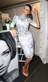 Miranda Kerr gave a wave at a Fashion's Night Out event in September 2012.