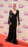 Miley Cyrus wore a black gown with a plunging neckline to the VMAs.