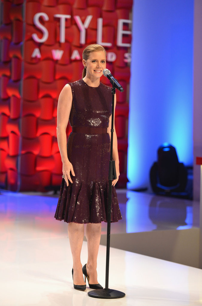 Amy Adams wore a burgundy dress to take the stage at the Style Awards.