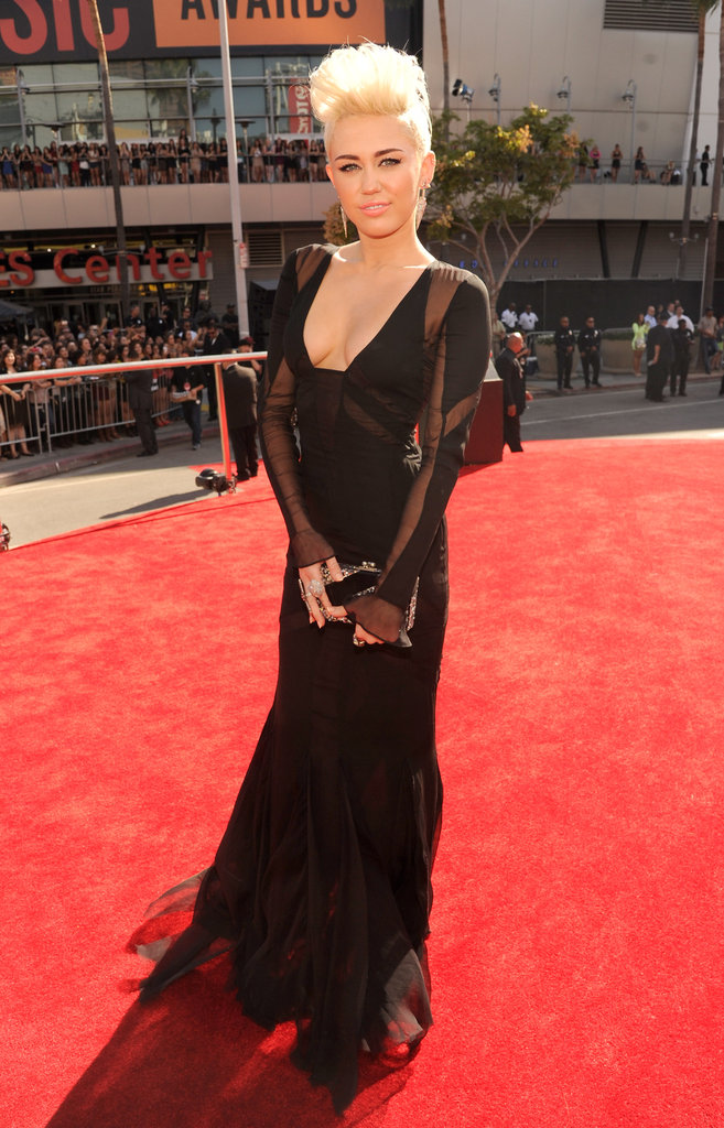 Miley Cyrus looked edgy but gorgeous at the MTV VMAs, wearing a sheer-paneled Emilio Pucci dress, which was then accessorized with an Edie Parker bag.