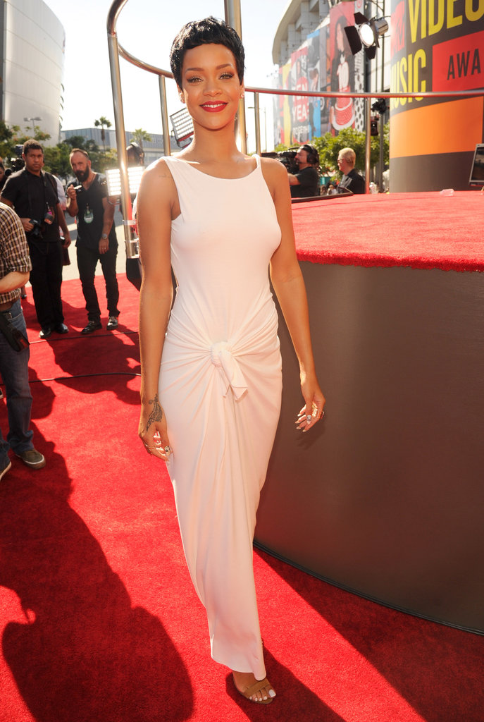 Rihanna looked stunning in a clean white Adam Selman gown, accented with a pixie cut and a red lip, at the MTV VMAs.