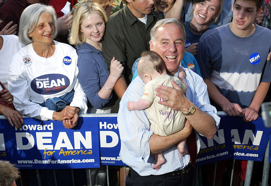 Howard Dean provided a tot with a shoulder to rest on during a campaign stop in Seattle in 2003.