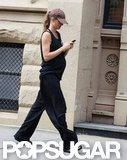 Gisele Bundchen let her baby bump show while walking home.