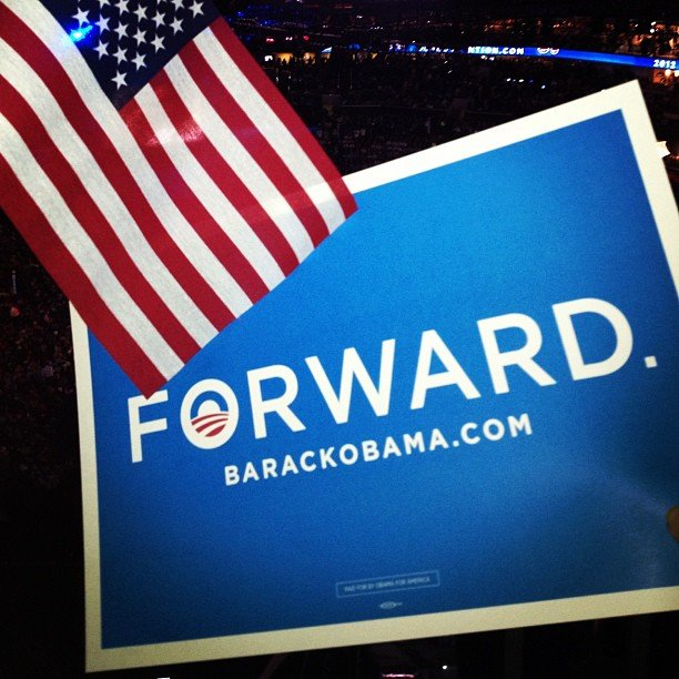 These signs and flags were passed out to attendees at the convention.