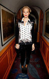 For the AnOther magazine launch party and Rag & Bone London flagship opening, Poppy sported a printed black-and-white silk top with sequined leggings, black ankle booties, and a sweep of red lipstick.