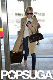 Kirsten Dunst wore a trench to the airport.
