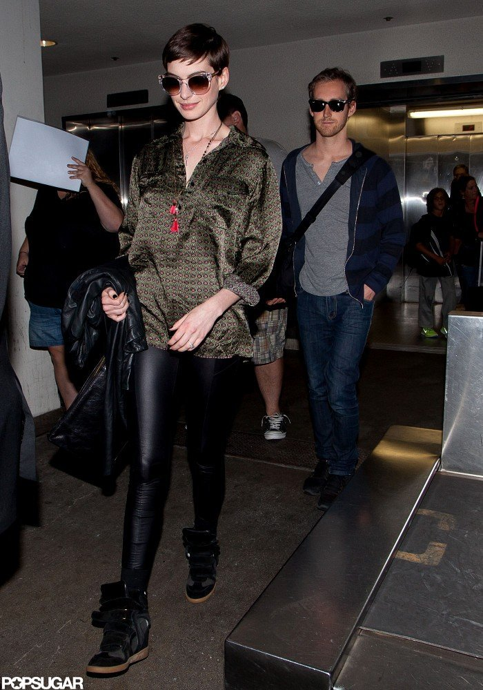 Anne Hathaway wore wedge sneakers.