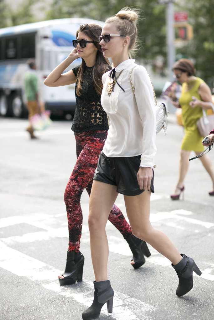 These girls were armed with cool-girl pieces like leather shorts and statement boots — and ready to hit the tents. Source: Greg Kessler