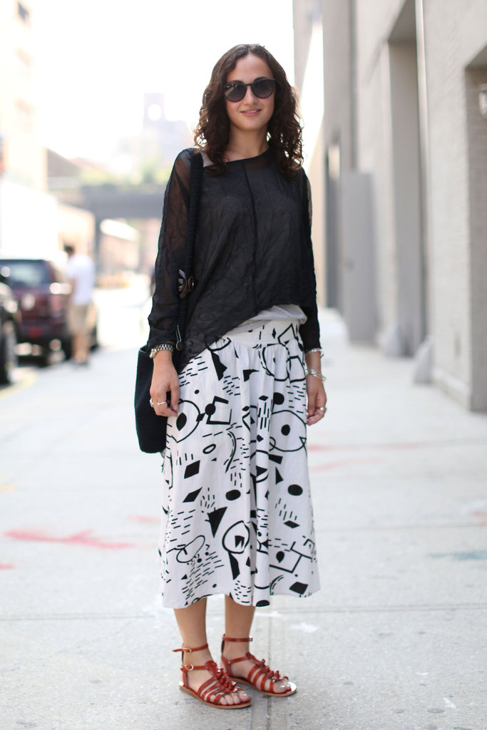 This printed skirt got an understated finish via a slouchy black top and flat sandals.
