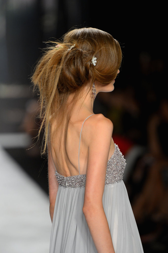 "Some of the words Badgley Mischka threw around for the hair look were chiffon, drapey, frothy, vintage petals, dusty colors, and lingerie. ""It's all about texture. We want it to float and feel like chiffon,"" said lead hairstylist Peter Gray for Moroccanoil. ""It's romantic with a twist."""