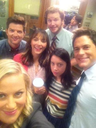 The cast of Parks and Recreation huddled up for a photo on set. Source: Twitter user iamrashidajones