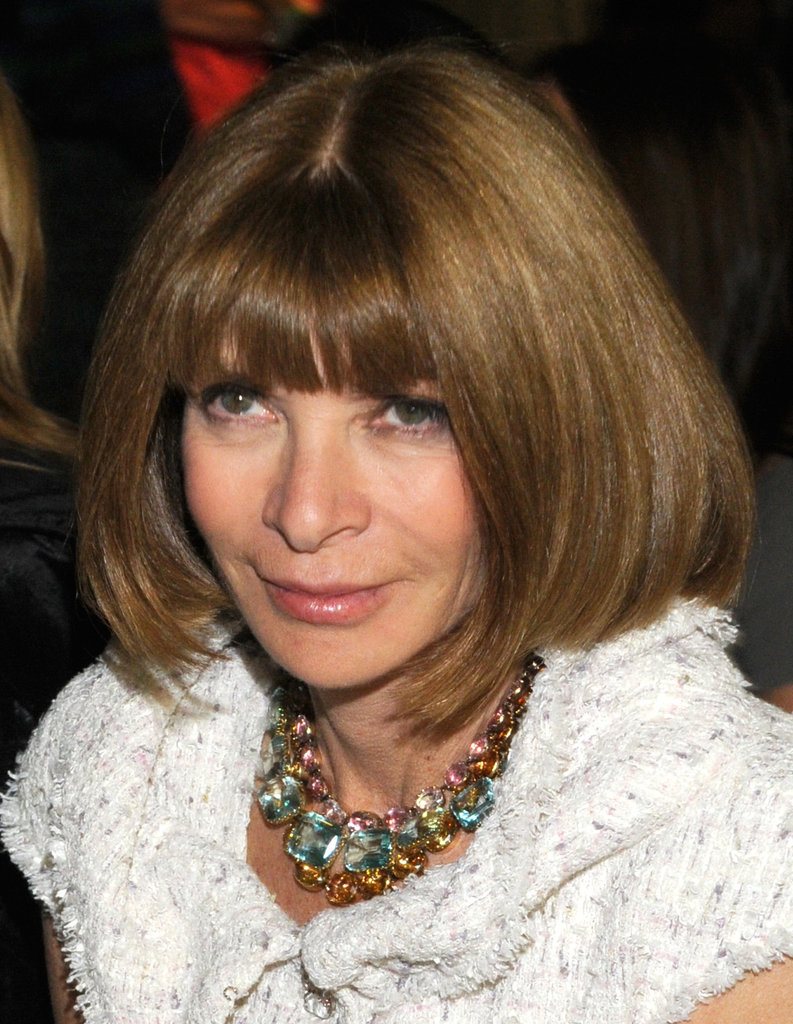 Anna Wintour wore a necklace with her white suit.