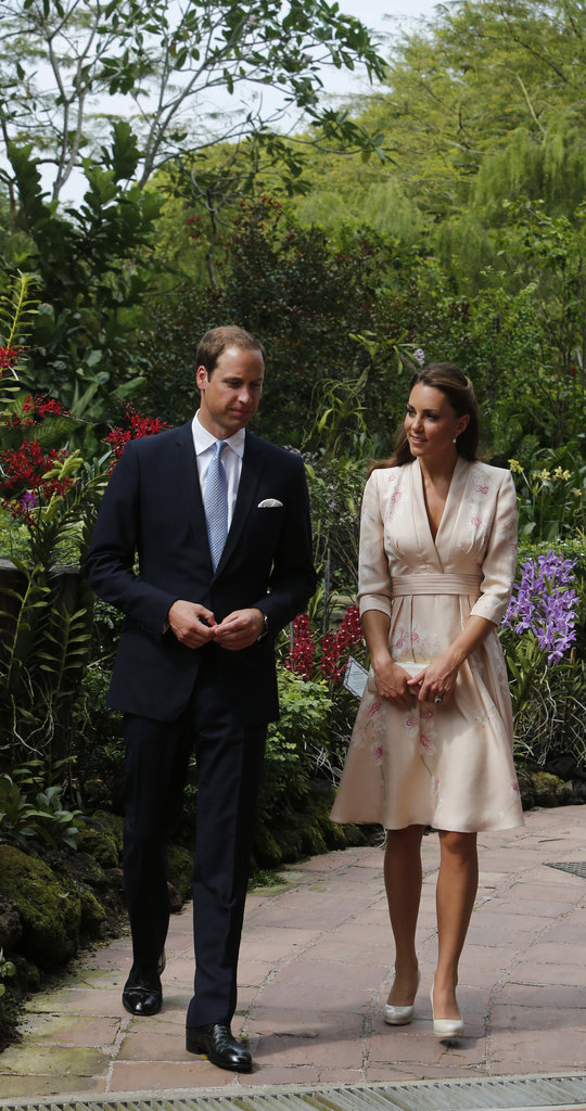 Kate Middleton and Prince William kept close as they arrived in Singapore.